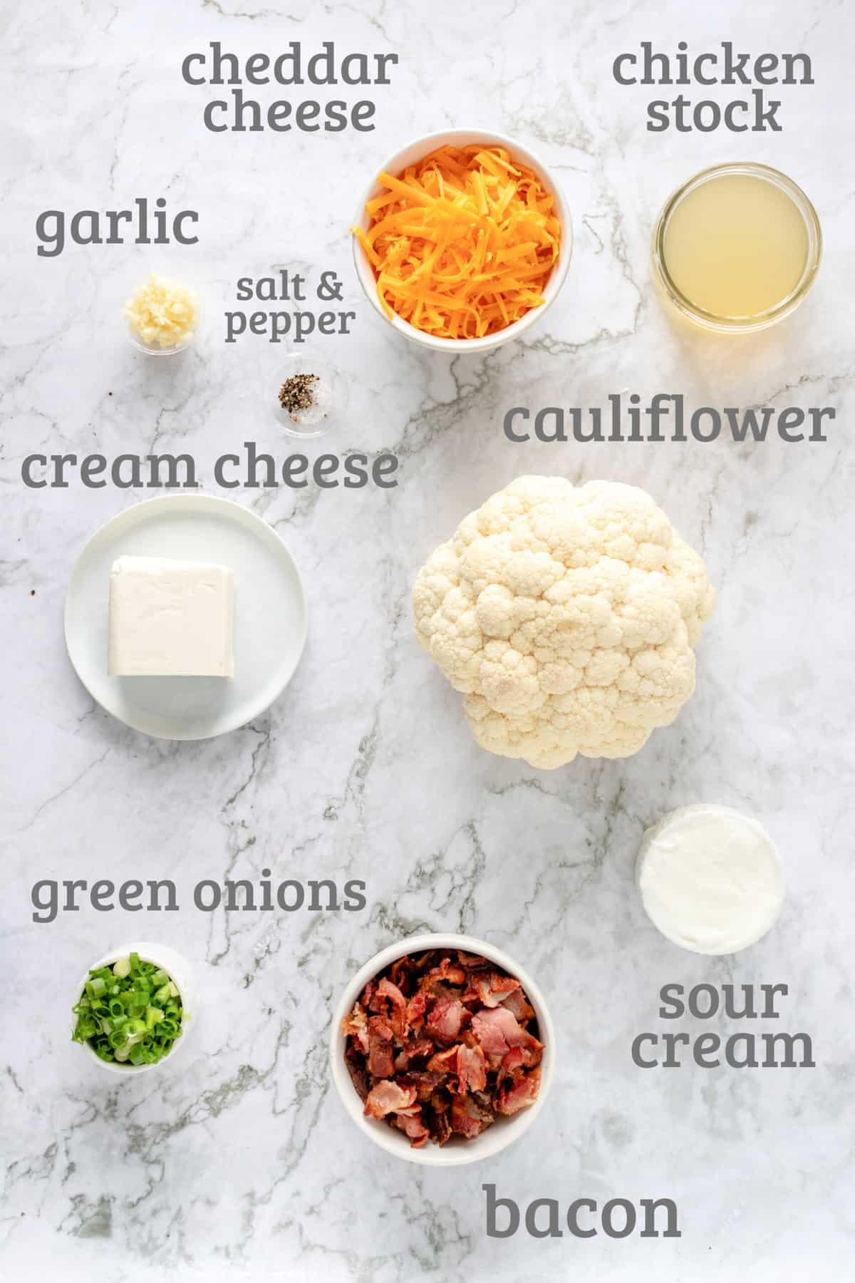 ingredients for loaded cauliflower casserole - cauliflower, bacon, cheese, onions, sour cream