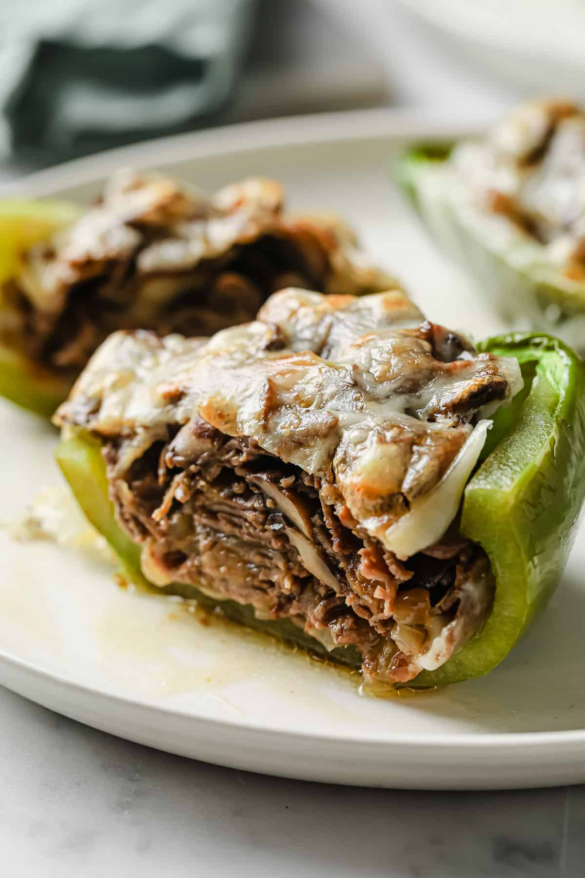 green bell peppers stuffed with roast beef, provolone cheese, mushrooms, onions, and garlic