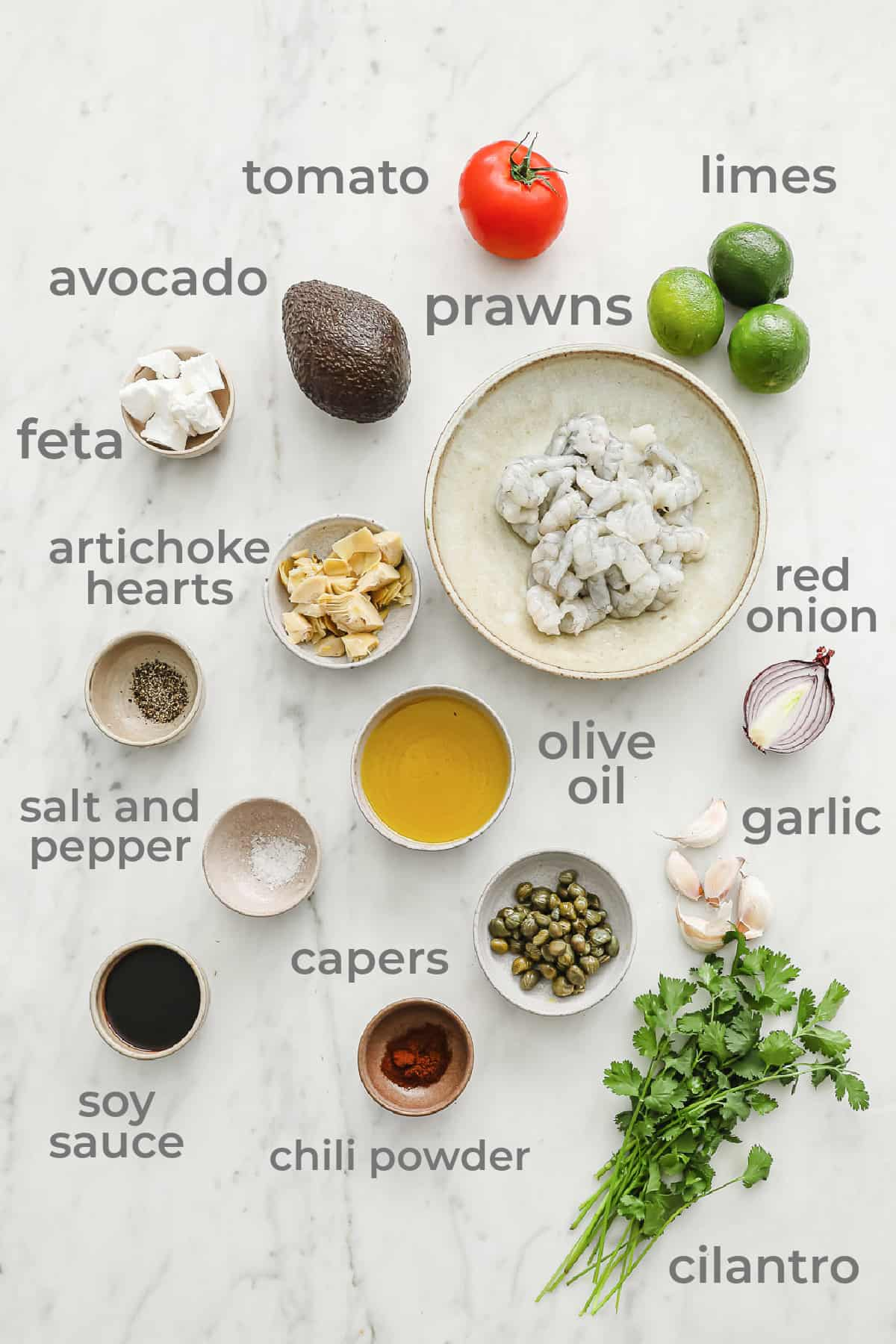 Ingredients laid out to make grilled prawns with an avocado feta salsa
