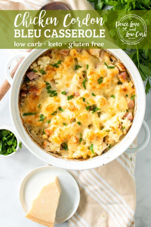 a white casserole dish full of a cheesy low carb chicken cordon blue casserole, garnished with parsley