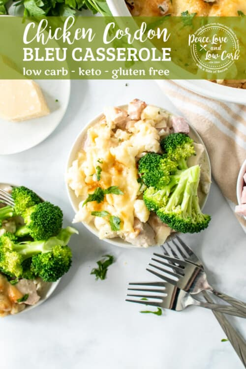 chicken cordon bleu casserole on a white plate, serving with steamed broccoli