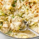 a skillet full of low carb tuna casserole, rich and creamy sauce, baked golden brown with cheese