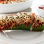 This Hasselback Zucchini Pepperoni Pizza is a fun low carb and gluten free spin on traditional pepperoni pizza. Who needs the crust?
