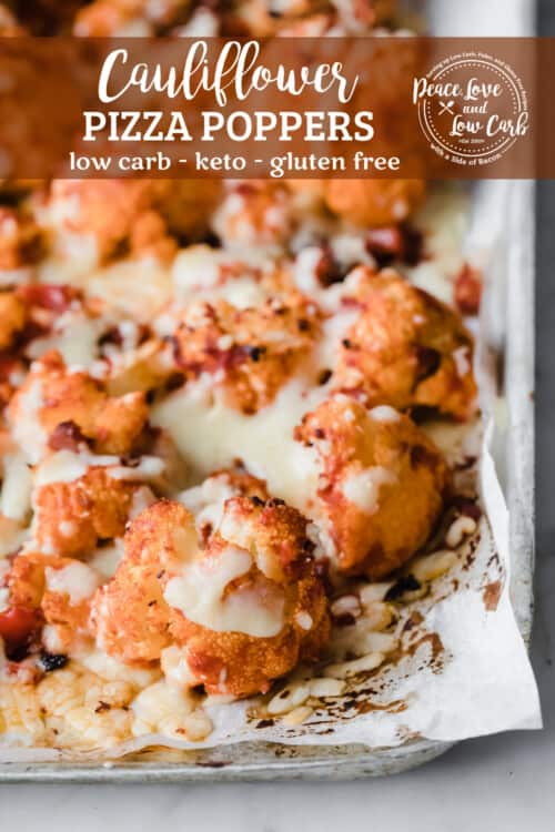 baking sheet with parchment paper with roasted cauliflower, topped with melty cheese and pizza sauce
