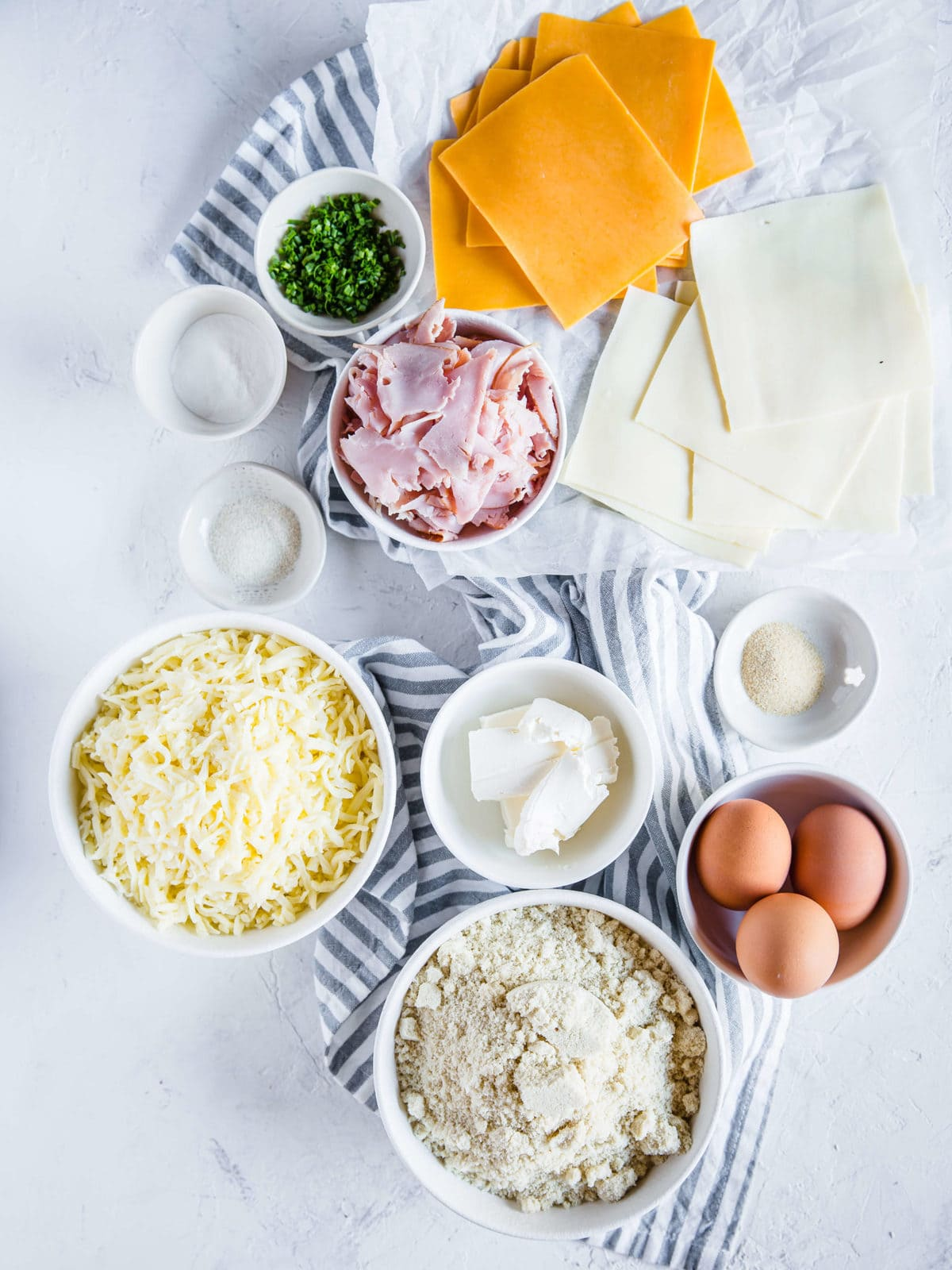 All of the ingredients to make fathead dough, plus ham, cheese, and chives to stuff Ham and Cheese Keto Hot Pockets
