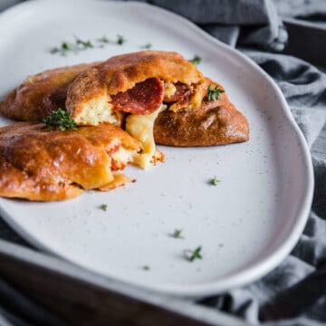 melty cheese and pepperoni inside a keto pepperoni pizza hot pockets