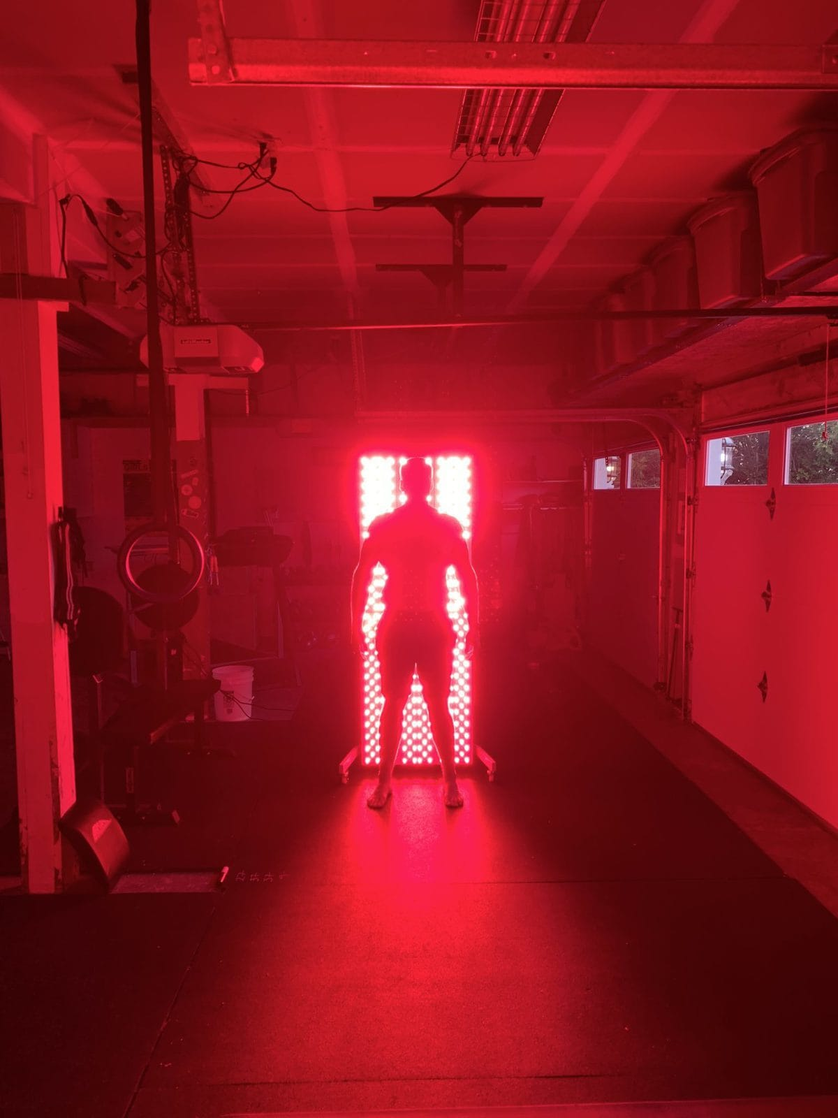 Jon Standing in front of the Joovv Elite red light therapy system for an all over body treatment