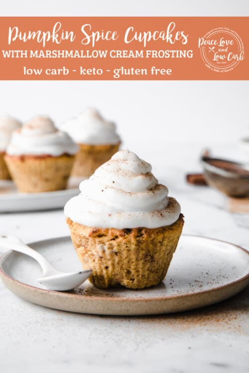 low carb pumpkin spice cupcakes, frosted with marshmallow frosting, served on a porcelain plate, with a spoon