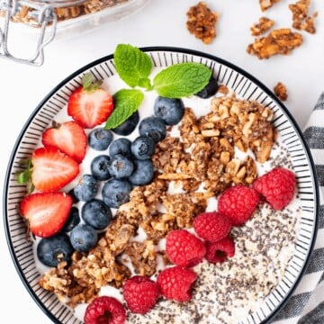 overhead shot of a yogurt granola parfait bowl.