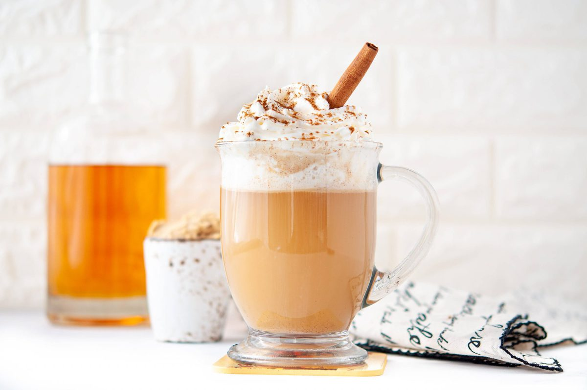Clear glass coffee mug, full of low carb cocktail - pumpkin spice hot buttered rum
