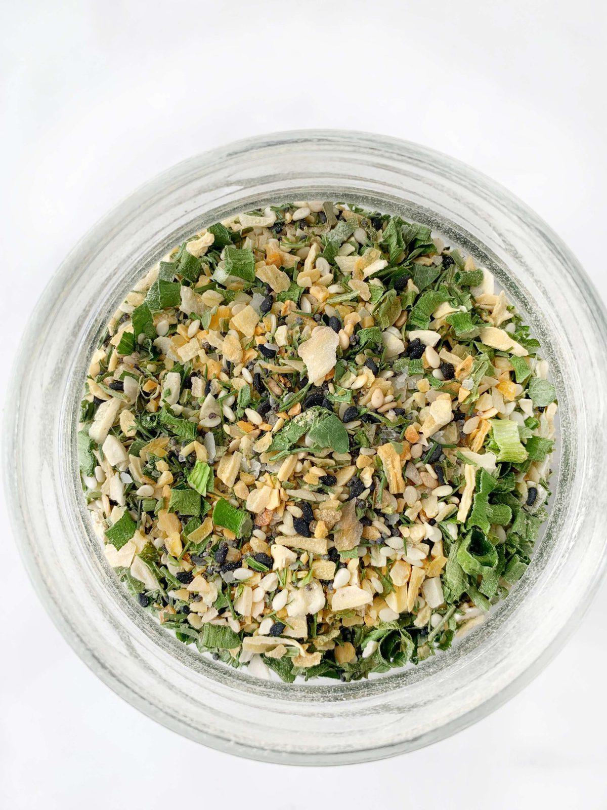 Overhead shot of an herbed seasoning mix in a mason jar