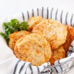 Basket of warm gluten free cheesy biscuits