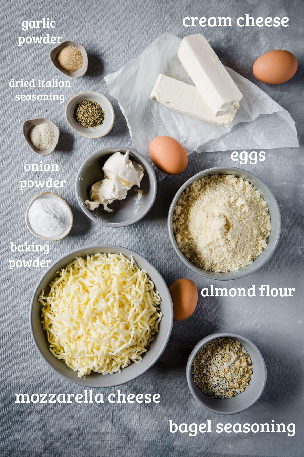 recipe ingredients for cream cheese stuffed everything bagel bites - cheese, almond flour, eggs, baking powder, seasonings