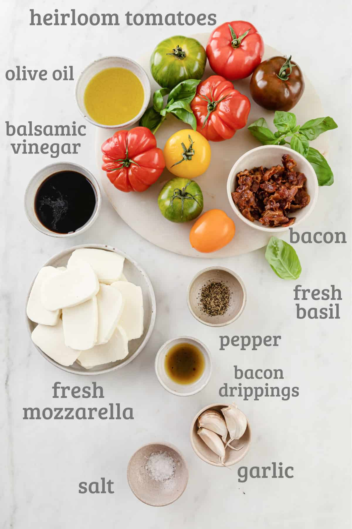 Ingredients laid out for a baked heirloom caprese