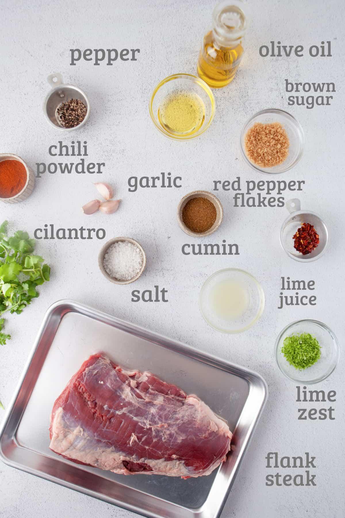ingredients for grilled flank steak - steak, limes, sugar, garlic, olive oil, chili powder