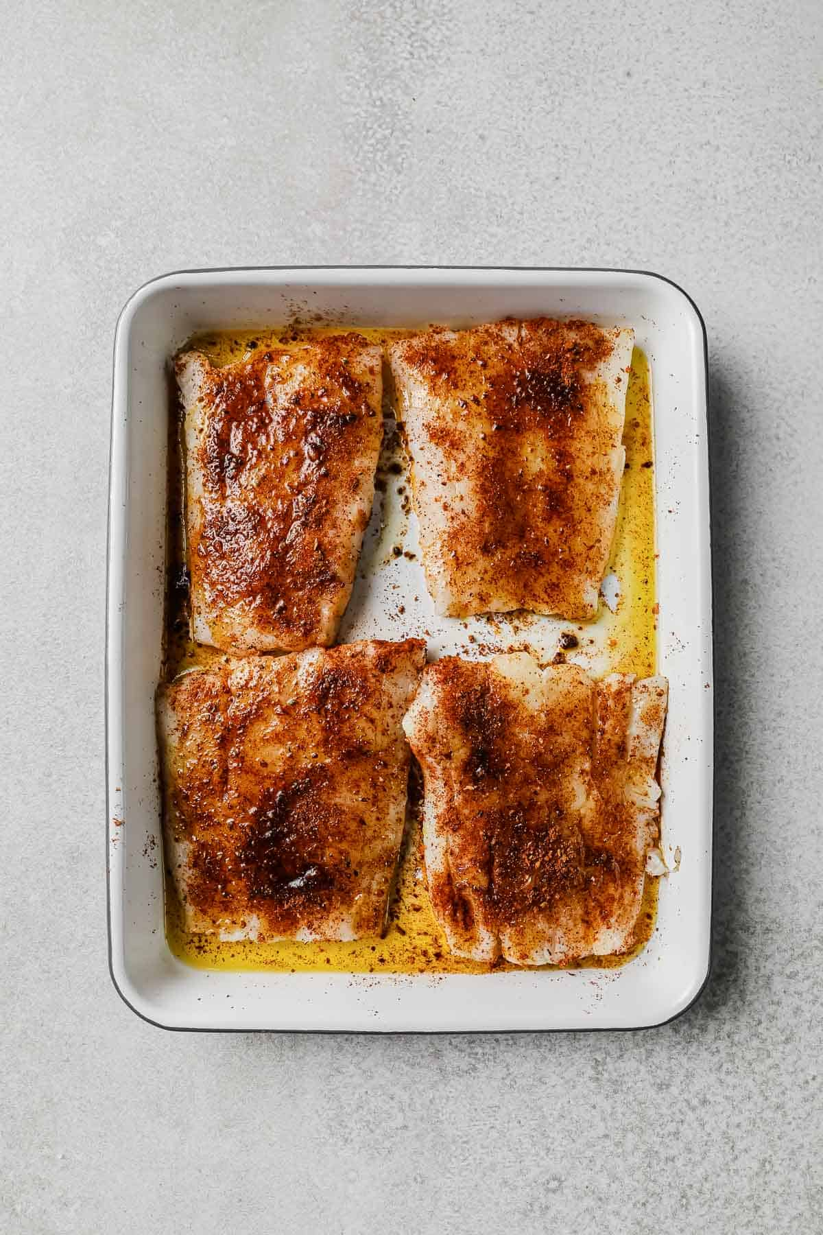 cod filets drizzled with olive oil and seasoning with taco seasoning