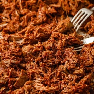 keto barbecue pulled pork, shredded and sauced on a sheet pan