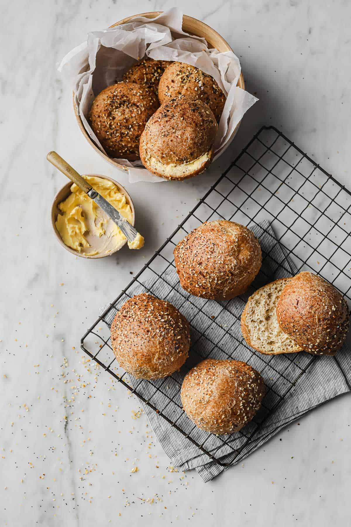 keto dinner rolls, served with everything bagel seasoning in a basket lined with parchment paper