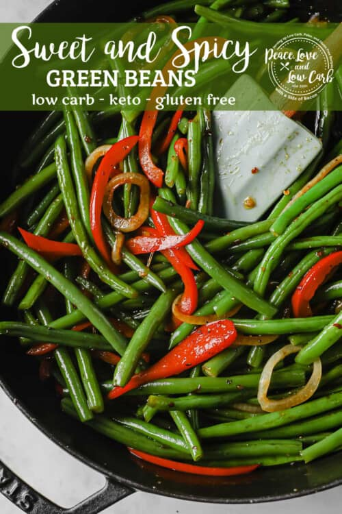 cast iron skillet with Sweet and Spicy Green Beans with peppers, onions, garlic, soy sauce, and brown sugar