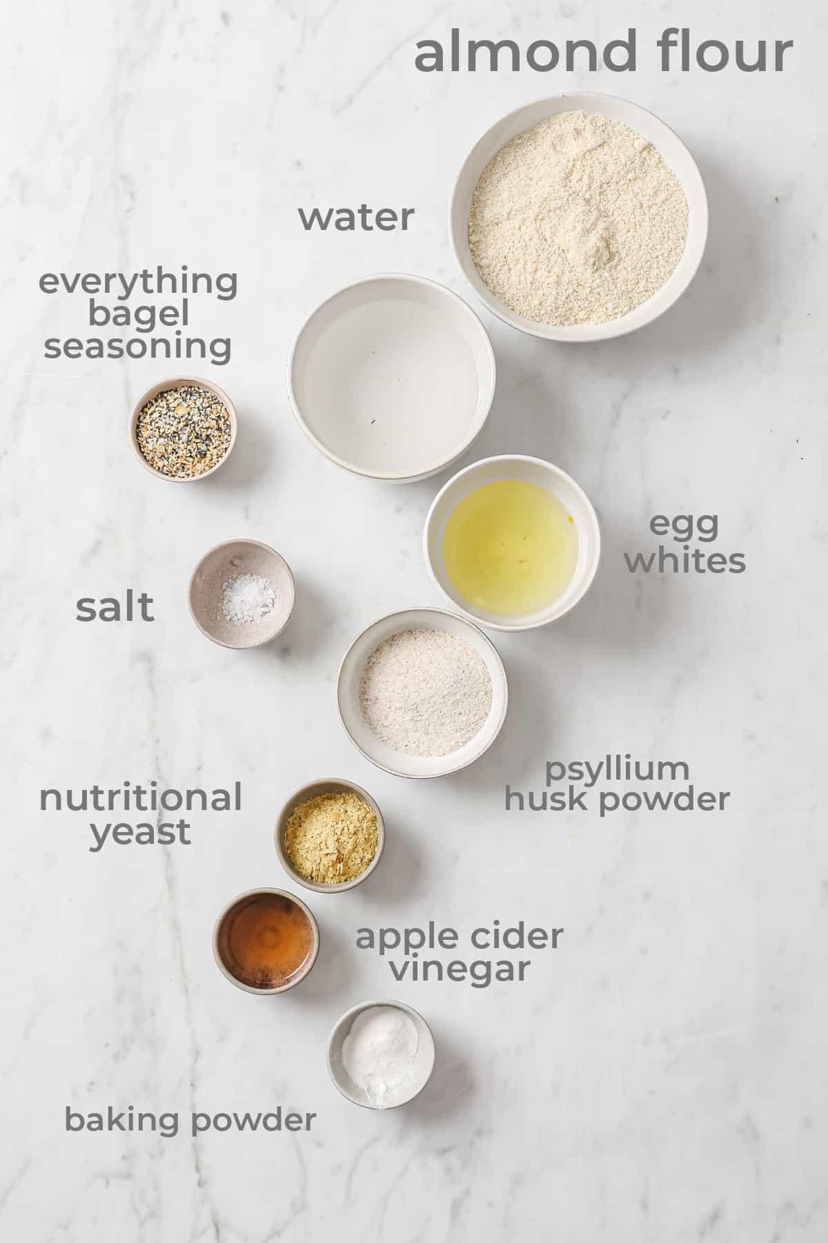 Ingredients for keto bread - almond flour, psyllium husk powder, eggs, bagel seasoning, nutritional yeast, baking soda