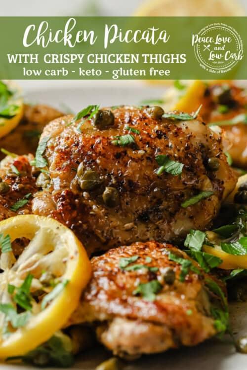 white plate full of crispy chicken thighs, lemon, capers, and fresh herbs