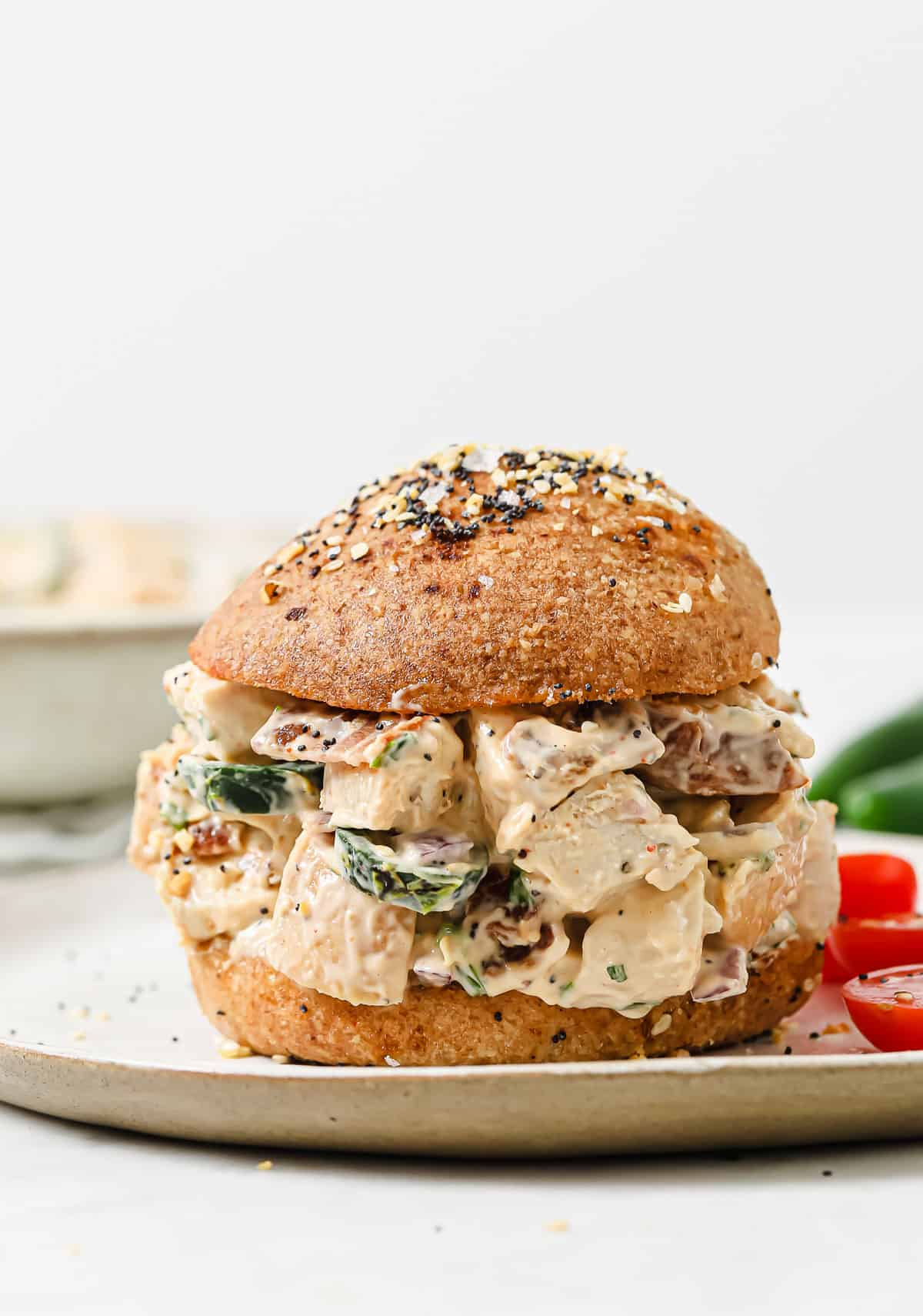 jalapeno popper chicken salad, piled high on top of keto sandwich rolls