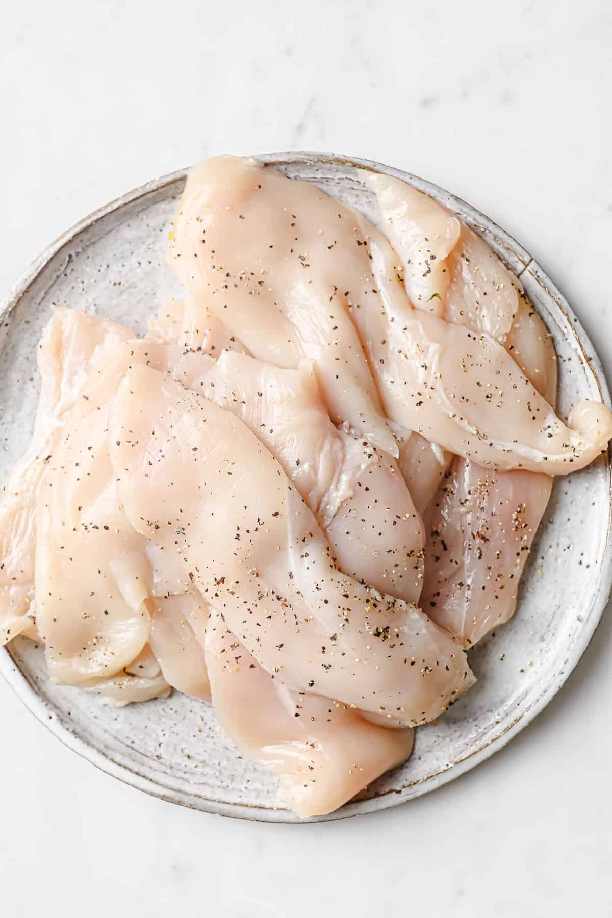 chicken breasts seasoned with salt and pepper