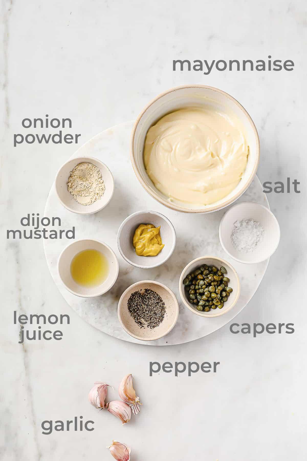 mayonnaise, dijon, garlic, onion powder, lemon juice, salt, pepper and onion powder all laid out in separate bowls
