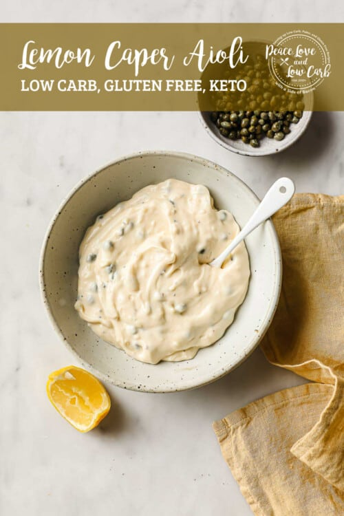 a ceramic bowl, full of lemon caper aioli, garnished with a lemon and capers